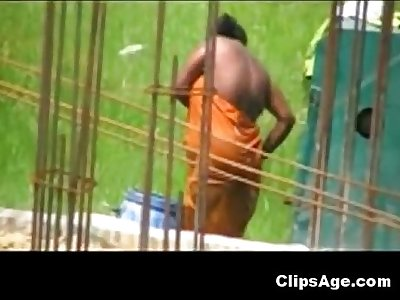 Desi woman caught bathing outdoors